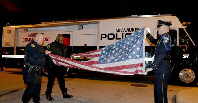 Milwaukee police retrieve flag burned at GOP debate protest