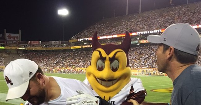 Official seeks $123,000 after university mascot jumps on him