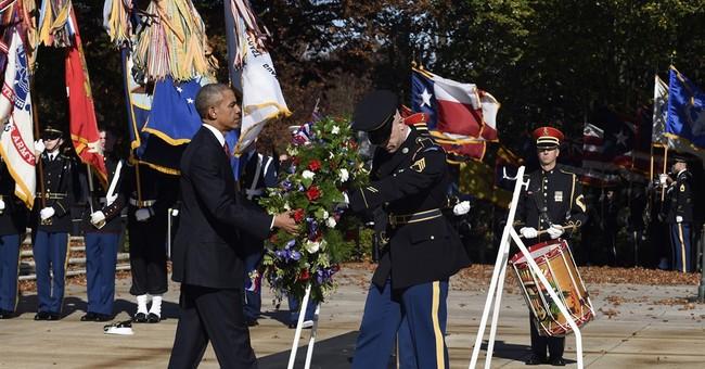 Obama visits Arlington National Cemetery to honor veterans