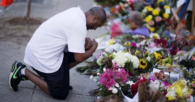 Volunteers continue sorting mementos after church shooting