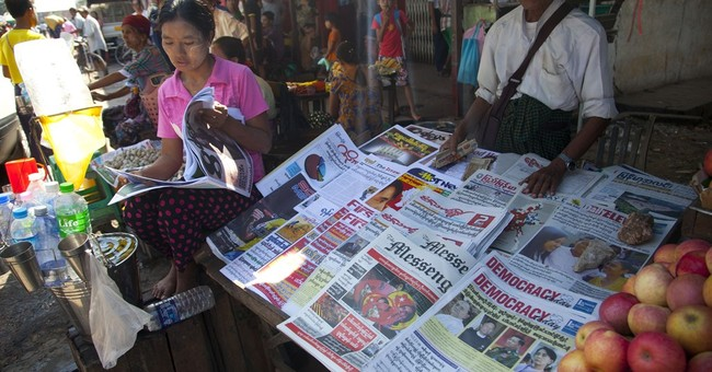 The Latest: Suu Kyi's party wins historic majority