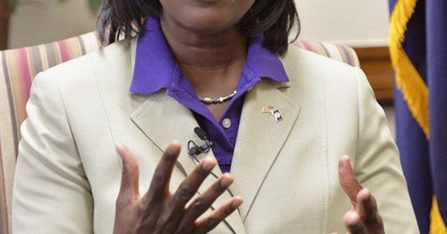 Kentucky's 1st black statewide official touts outsider story