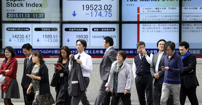 Asian stocks slump on Fed rate hike fears, commodity rout