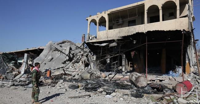 Kurdish forces recapture militant-held towns in Iraq, Syria