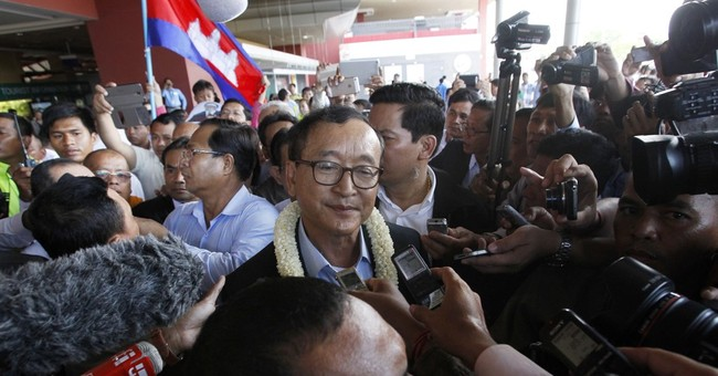 Cambodia court orders arrest of opposition leader Sam Rainsy