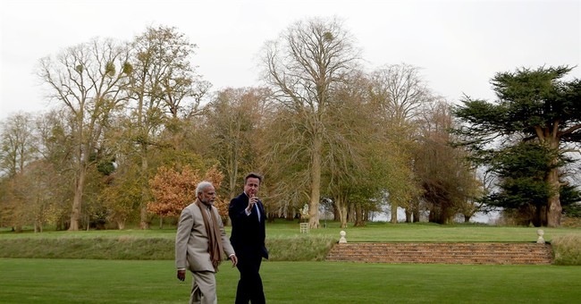 India's Modi meets queen, rallies fans on 2nd day of UK trip