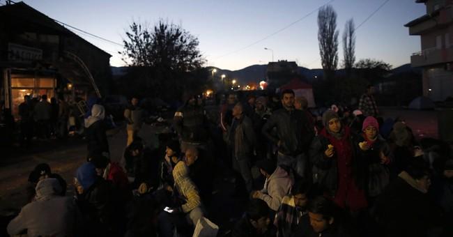 The Latest: Merkel still not prepared to set refugee limit