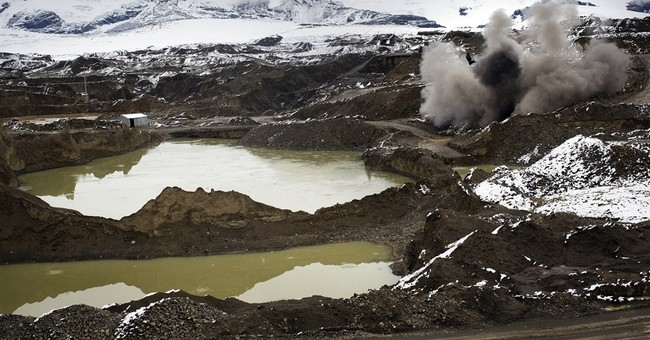 AP PHOTOS: Police climb Andes to destroy illegal gold mines