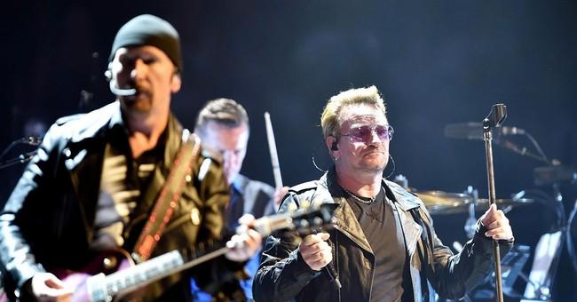 U2 'shocked' by deadly Paris attacks, cancels concert