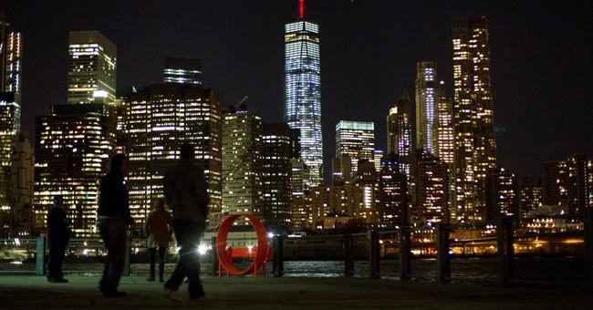 Empire State Building dark; WTC lit after Paris attacks