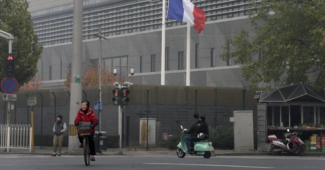 Paris attacks reaction:  Condolences and condemnation