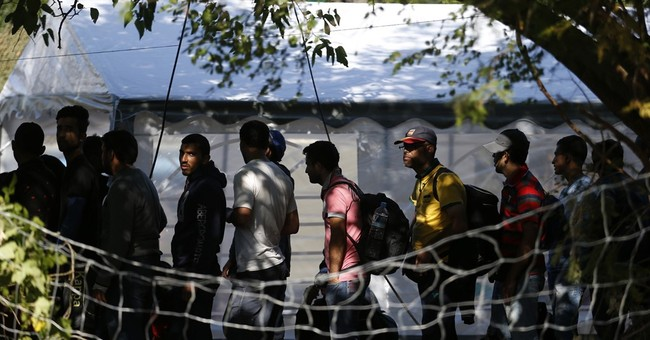 Focus on passport in Paris highlights lack of migrant checks