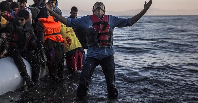 The Latest: Swedish police increase checks at asylum sites