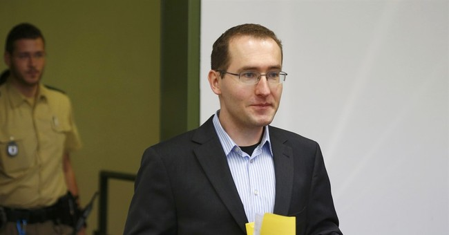 Former German spy goes on trial on treason charges