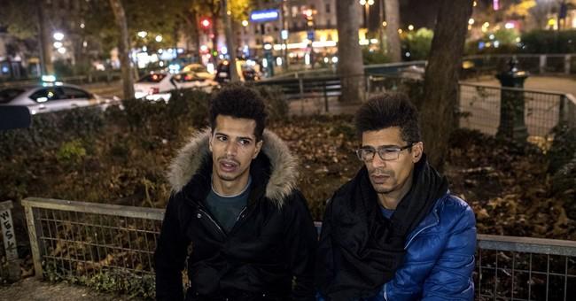 Diverse Paris mourns together after indiscriminate violence