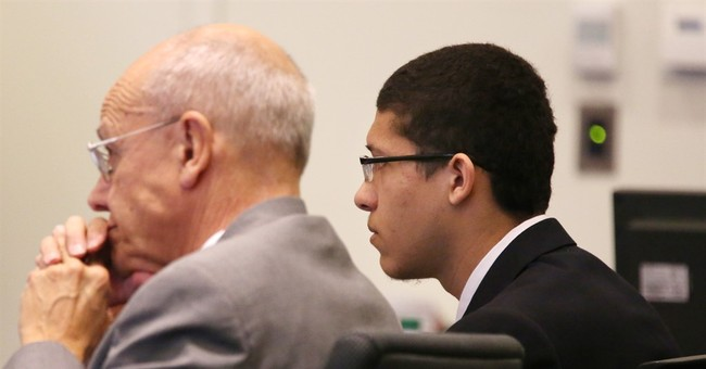 Teen charged with killing teacher refuses to enter courtroom