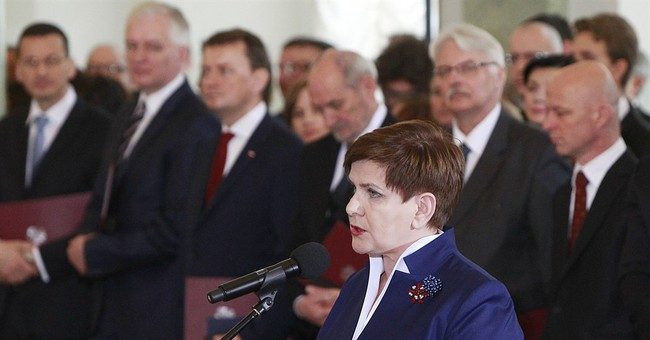 Polish leader condemns 'German arrogance' amid migrant spat