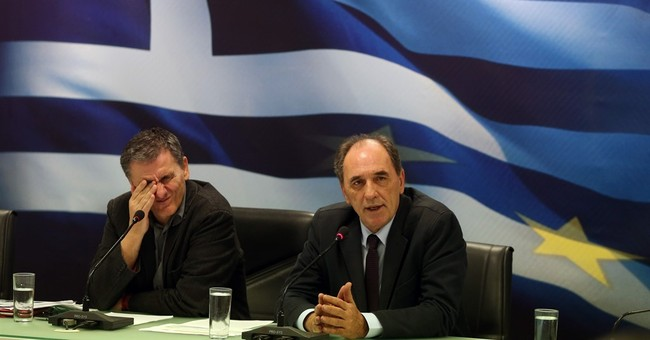 Greece and creditors in deal to release more bailout cash