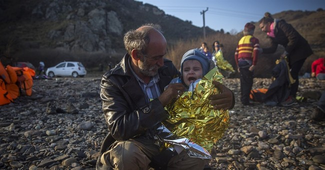 The Latest: UK: No new restrictions on refugees after Paris
