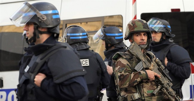 The Latest: France backs away from raid suicide bomber claim