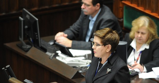 New PM: Poland to help fight terrorism, reserved on migrants