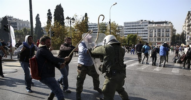 Protesting Greek farmers clash with police in central Athens