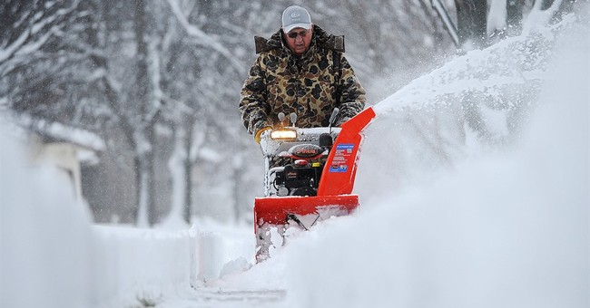 Storm blankets parts of Midwest with more than foot of snow