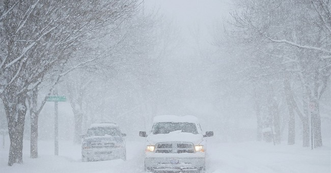 The Latest: Snow, ice covering roads in northwest Illinois