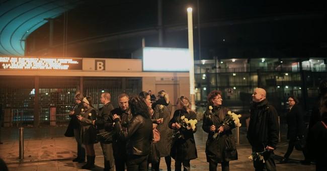 1 week after attacks, defiant Parisians honor the dead