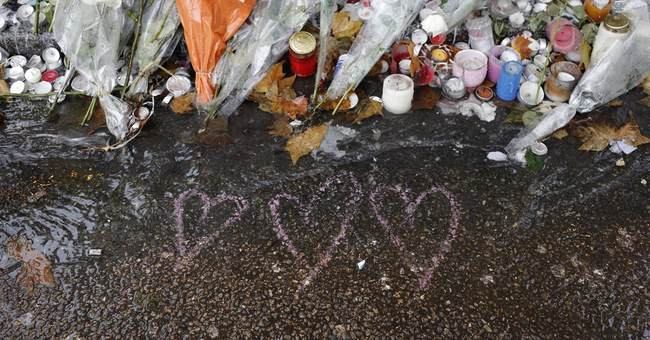 Parisians voice shock, defiance a week after attacks