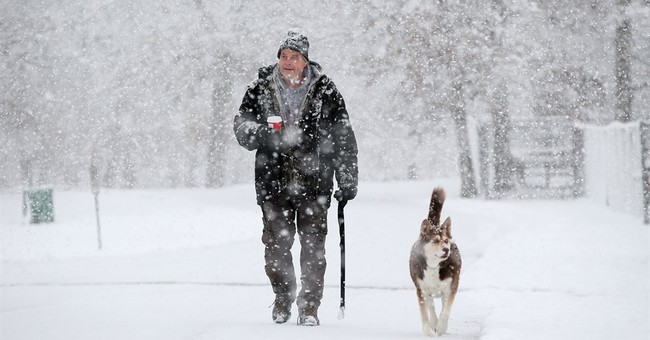 Snow piles up beyond expected amounts in Wisconsin, Illinois