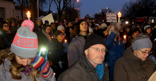 The Latest: Protests continue over fatal police shooting