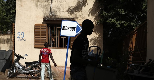 The Latest: Senegal president visits Mali attack site