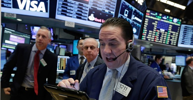 Most Asian stock markets lower as commodity slump weighs