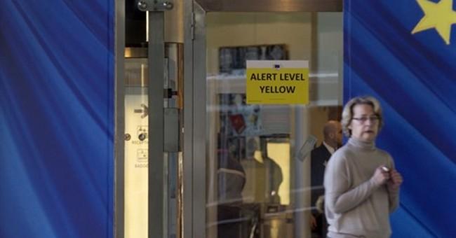 Brussels on high alert as police hunt Paris attack fugitive