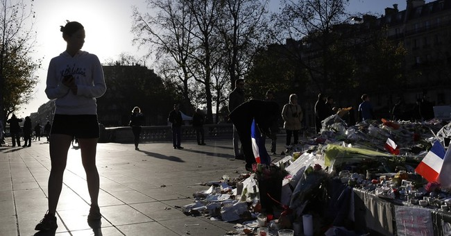 French economy already hurting from attacks, survey finds