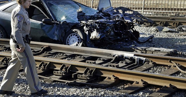 Part of Los Angeles commuter train derails after hitting car