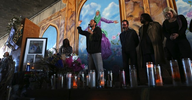 Man charged with killing artist working on peace mural