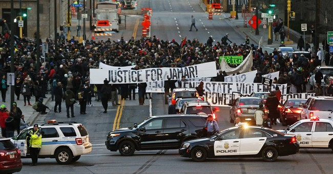 The Latest: Hundreds remain at Minneapolis protest site