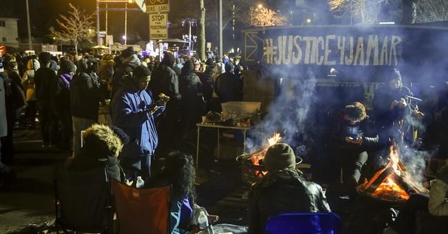 The Latest: DOJ representatives attend Minneapolis protest