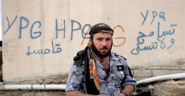Kurdish fighters in Iraq struggle to hold gains against IS