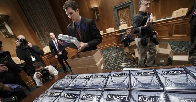 Obama says budget must balance economic, national security