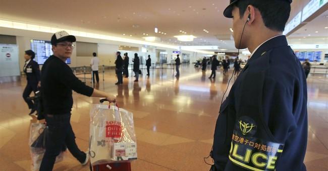 Japan's leader defends handling of hostage crisis