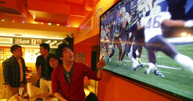 From Rio to Tokyo, sports fans flock to watch Super Bowl