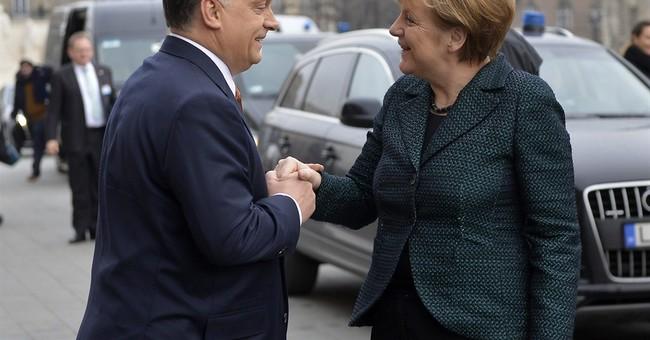 Merkel: Germany won't give weapons to Ukraine, favors talks
