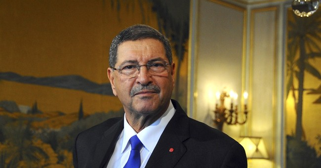 Tunisia presents new coalition govt with token Islamist spot