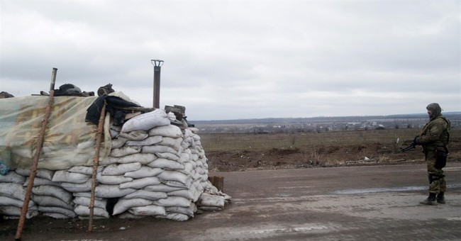 Ukraine troops fight to avoid being surrounded by rebels