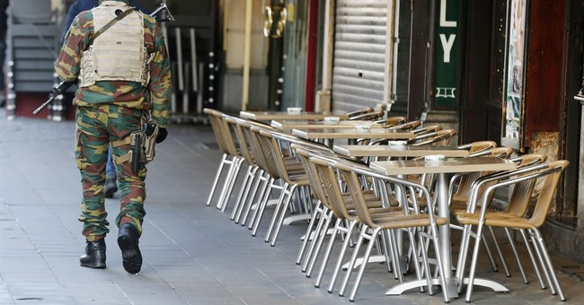 The Latest: Belgium says likely Paris fugitive gets help