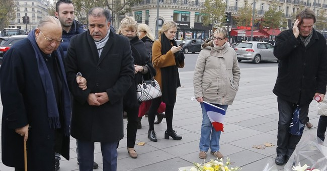 France honors attack victims in city subdued by mourning