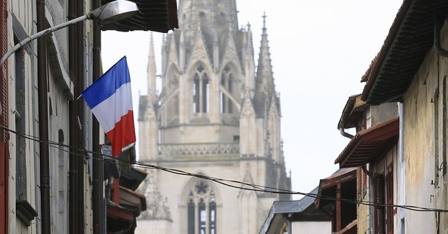 The Latest: French court keeps 2 suspects under house arrest